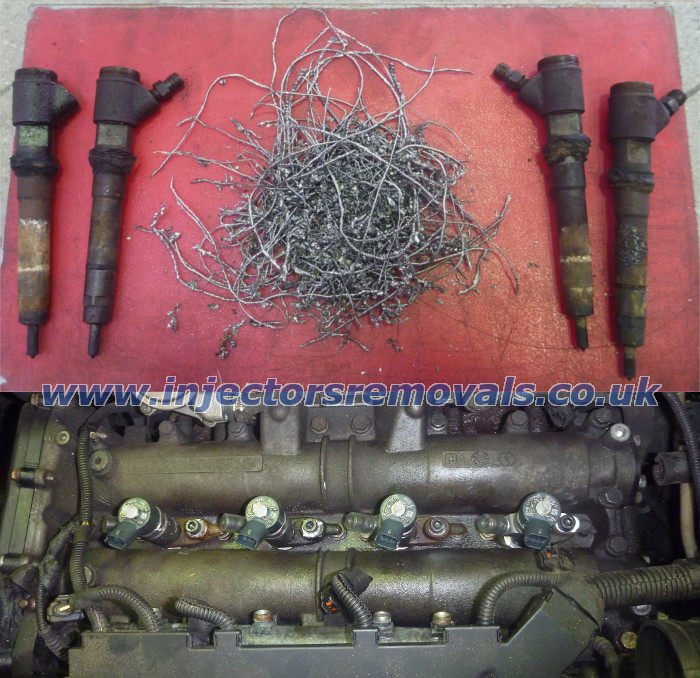 Broken injectors and bolts removed from Fiat