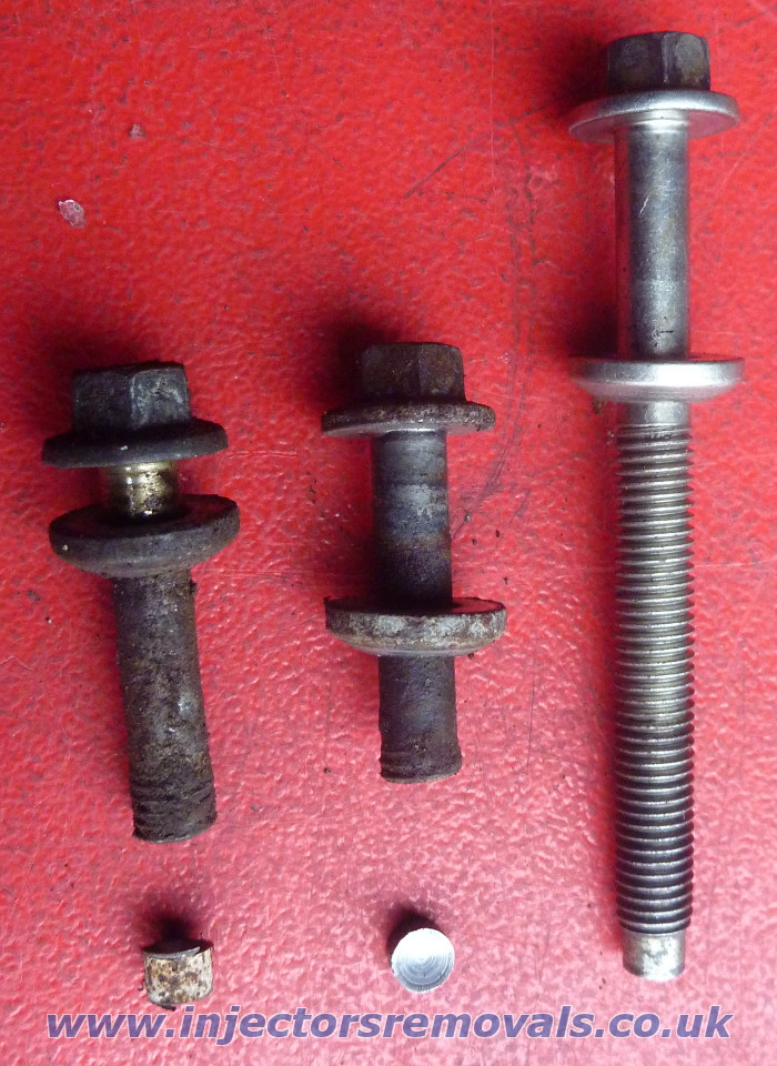 Broken injector clamps bolts removed from